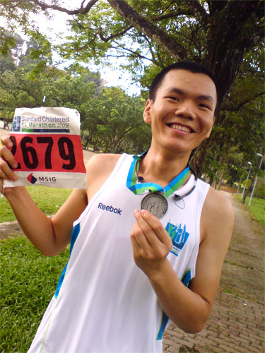 Jenn Ting with his medal